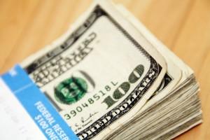 $100 bills by 401(K) 2012/Flickr